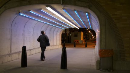New pedestrian tunnel on Clinton Street underneath the rebuilt viaduct, illuminated by newly-installed LED uplighting.