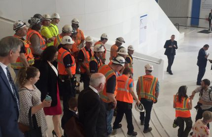 Attendees descend the east staircase after the opening