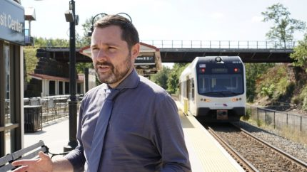 Stewart Mader talks with customers at Pennsauken Transit Center near Philadelphia