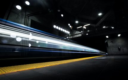 A Montreal Metro train passes through De La Savane station. Photo by William Daigneault.